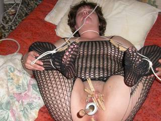 tied down with her tits and clit clamped then fucked with a baseball bat