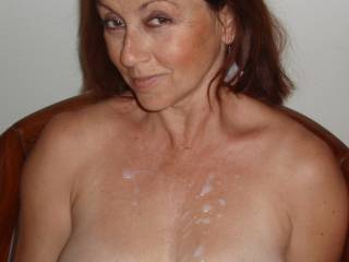 Candi Annie shows off her cum covered chest after Al sprayed her with a warm load of her favorite juice!  Care to add to it?