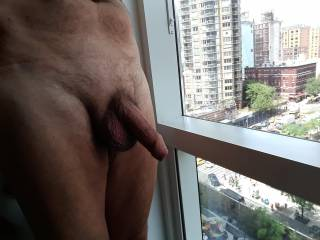 Another view from my hotel room. Just love the anonymity of being naked in the window of a building in a far away city. How about you? Tell me if you like to do the same.