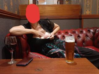 Flashing tit in hotel bar