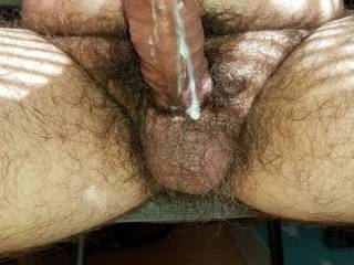 Sitting the sun on my patio stroking my cock to a nice cum eruption.