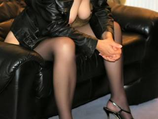 Oh yeah, you sure are teasing...my cock is so hard, you have sexy legs and delicious looking breasts.  Mmmm, K (my wife) and I think you are hot and would love to get in between your gorgeous legs.  Ooooo, a nice bush shot of you would be delicious.  Sit back in that chair and let us tease you sweetie. We love your pics.   K & G