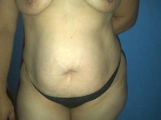 i want to cum all over that sexy tummy as i suck them tits