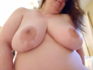 Yes they are fun to suck on. She says she\'s a F-cup for all you tit fans. She\'s still fucking me in this pic