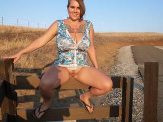 WOW what an amazing shot of an amazing pussy i would love to have my head between those legs and go go to town on that clit you would  have to really grip the fence so you wouldnt fall off when i was done
