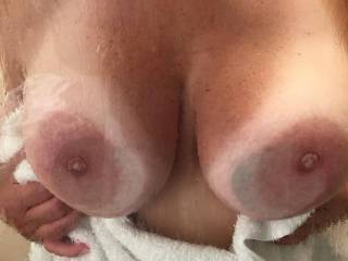 Her lovely tits pressed against the shower at our resort