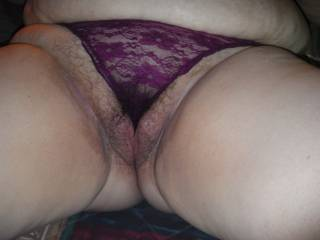Great pic , those panties can hardly contain that massive hairy pussy mound and i love the way her big belly is spilling out over the top of them