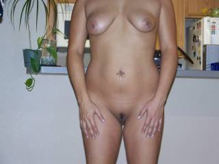 Sexy curves. Love the piercings! Gotta give her a 10! She's got my dick hard as a rock right now!