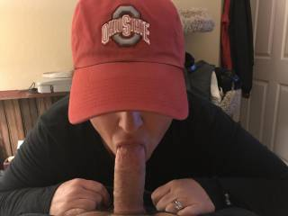 My wife sucking my cock first thing in the morning..... Go Buckeyes.... I then bent her over the bed and fucked good and hard giving her my morning load!