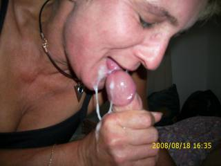 Looks like she is really enjoying your cum. Great photo.