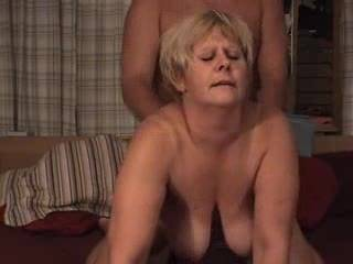 Watch her tits sway as she takes the cock hard from behind and gets a load shot in her