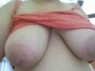 Wife's huge knockers! Love sucking and fucking them after work!