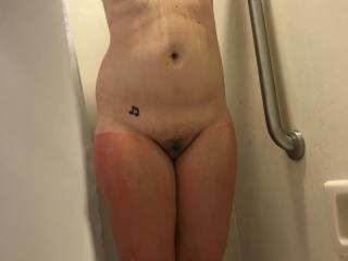 Wife in shower after day in the sun