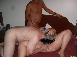 A mouth full, pulling his head to her pussy and gripping a stif cock, that's what I call multi-tasking! Good girl  grrrr
