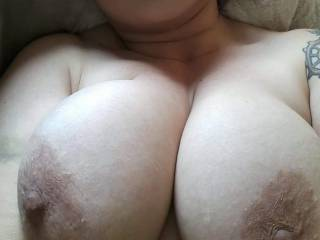 While hard at work suddenly my phone alarmed, when I checked it I found this picture of my wife telling me she was so horny waiting for me. What would you do too her huge tits?