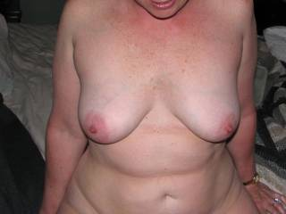 my wife's beautiful tits. she loves having her nipple sucked.