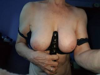 Busty mature Irene plays with her dildo between her big tits