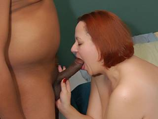 Oh yes what a hot sexy lady and you look fantastic with that BBC in your mouth sure wish it was me you where sucking off Mmmmmm