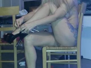 Oh sweetheart what's not to like.  A gorgeous woman putting on her CFM shoes and flashing some pussy and she has beautiful legs.  Like it....fuck sweetie I love it.  Damn.....you are so hot.  G