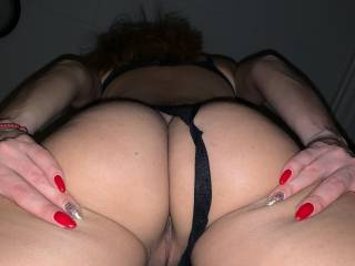 Spreading her tight ass