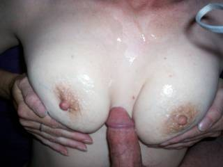 I dont blame him!! I would love to add my hot load all over those great tits!!!!