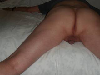 Laying spread eagle on the bed