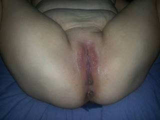 Hubby licked, fingered,  and slapped my clit and then we fucked till he came deep inside me and I squirted all over us.