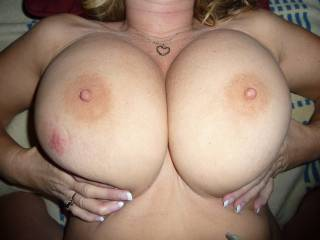 or 2!! would love to see a group of guys jerk off all over her nice big sexy tits!!!