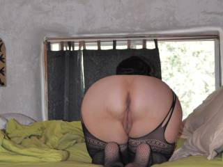 Her wonderful, round ass and a peek at her pussy. Just so nice and round with such a nice pussy.