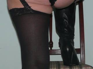 Lacy panties and black boots.
