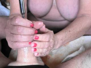 One of several Photo\'s of Girlfriend using a sex toy on my dick, long metal rod, known as Sounding Along with a Hand Job at the same time. Feels sooooooooooo good. Would you try?