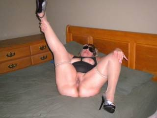 My hotwife\'s boyfriend ordered her to lay down on the bed and spread her legs while he snapped some photos. He fucked my wife while she was dressed in this outfit with her heels on!