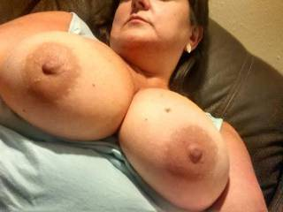 If you invited me over and walked me over to the couch, I'd get your big tits out and give them some much needed attention. Then, I'd remove the rest of your clothes and give my full attention to you elsewhere ;-)