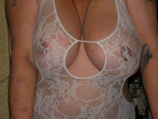 getting her nipples darken my tattooing and she loves wearing see thru outfits hope you all like