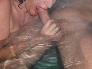 Steamy fun in our spa, with our swinger friend, when he came around for a threesome. Sucking his lovely thick cut cock.