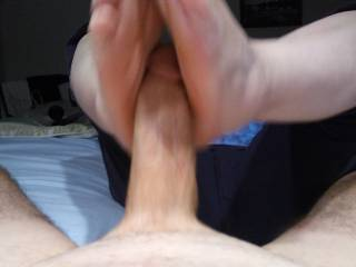 I so badly want my Hubby's cum! It is time to take care of his hard thick cock with my feet. If you want to see more, check out our video.