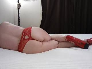 Waiting for your cock. I am a very bad girl... Just slip it in from behind, and pound me hard, dear.  Would you like to do it to me?