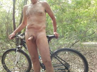 I Found an old, unused road thru a forest. Perfect for bobbing along on my bike.I just love being naked outdoors.
