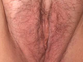 Close up of the wife\'s tight wet pussy.