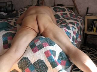Lying on my bed naked, thought that I would snap a pic of my ass in a slightly different position