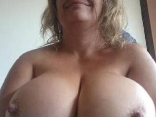 I am having this recurring fantasy about lubing up your incredible titties, sliding my throbbing cock between them (almost getting lost in there) while you press them together and I pull those HUGE nipples....MMMMMM