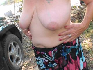 We were at the lake and I was running around outdoors with my dress pulled down showing off my tits. Wonder if the neighbors saw me, would you look?