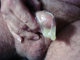 this picture of you filling a condom with cum got my attention, jacked off ans squirted a hot load looking at it, thanks