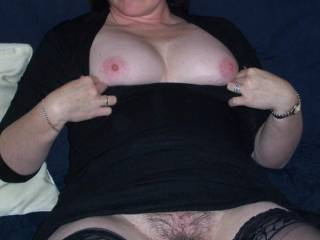 Look at that nice bush , would like to taste that sweet pussy ,  Whilst pulling on them nice nipples mmm x