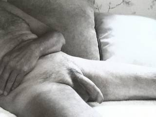 Another black and white pic of my uncut cock while I am sitting around my friend's apartment. Let me know if you enjoy this B&W look.