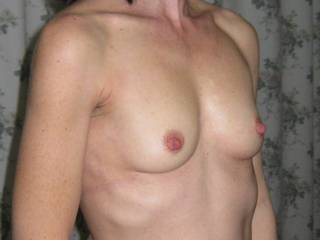 Awesome, shapely tits, I'd love to caress them, and anything else you feel needs caressing.