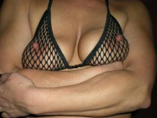 wonderful tits, and the nipples perking through the net look soooo horny!!!