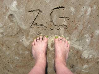 For those foot lovers....I hope you enjoy this as much as I enjoyed sinking my toes into the wet sand for you. :D Lily