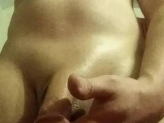 Putting some oil on my freshly shaved cock!!