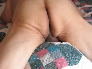 Lying on my bed naked, thought that I would snap a pic of my ass in closer view and slightly different position